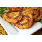 Puerto Rican Tostones (Fried Plantains) - Crispy fried plantains. A plantain is a very firm banana. Serve as side dish with your meal or as appetizers.