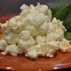 Coconut Ambrosia Salad - There 'll be twelve happy people at your table when you spoon us this delightful salad/dessert, made with Mandarin oranges, pineapple, whipped topping, coconut, marshmallows and, of course, maraschino cherries.