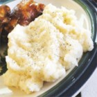 Roasted Garlic Mashed Potatoes - Russet potatoes are blended with roasted garlic, butter and milk.