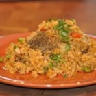 Arroz con Pollo II - Chicken and rice simmered with saffron, tomato sauce, bell pepper, onion, garlic, peas and beer.
