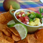 Quick Mango Salsa - This fruity salsa is great with pita chips. You could use it to top salmon or your favorite grilled fish, steak, or pork chop. You can add pineapple for even more of a tropical flair. The possibilities for this recipe are endless!