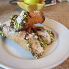 Cannoli - Make your own classic Italian confection with this recipe filling prepared cannoli pasty shells with a mixture of chocolate chips and ricotta cheese.