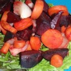 Spicy Beet and Carrot Salad - Roasted beets, carrots, and onion, tossed with an interesting black tea salad dressing and served on arugula with goat cheese, bring their big, bold flavors to your salad bowl.
