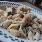 Tuna Macaroni Salad - The dressing makes the difference in this salad. Mayonnaise, a bit of milk, and a package of dry ranch salad dressing mix combine to make a delicious dressing for the tuna, peas, carrots, and cooked macaroni. Chill and serve to six.