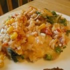 Mexican Sour Cream Rice - Baked rice with cheese, diced chiles, cilantro, corn, and sour cream. Would be great served with green enchiladas!