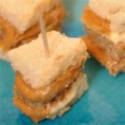 Creamy Peanut Towers - These are perfect for potlucks, get togethers, or as snacks for the kids. Everyone loves them! You may want to quadruple the recipe. Use toothpicks to keep the creamy towers from tumbling.