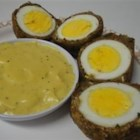 Scotch Eggs with Mustard Sauce - Scotch Eggs are part of the traditional Scots breakfast. They are also sufficiently versatile to be served hot with gravy at teatime, or cold as a snack.