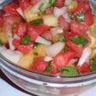 Watermelon Salsa - Watermelon, crushed pineapple, sweet onion, cilantro, orange juice and Tabasco make a refreshing summer twist on salsa. Bring copies of the recipe whenever you bring this, people will beg for a copy! Serve with tortilla chips.