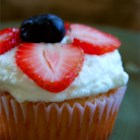 Independence Day Cupcakes  - Lightened-up vanilla cupcakes are filled with sugar-free pudding mix, topped with light whipped cream, and given a pretty red and blue star decoration made of fresh blueberries and strawberries for a patriotic dessert that's served cold.