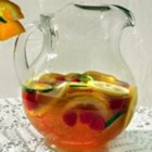 Sunset Sangria  - This sweet and refreshing punch makes a beautiful centerpiece for your next summer gathering. With sliced citrus fruit, raspberries, and pineapple juice, you may want to make a couple batches--just in case.
