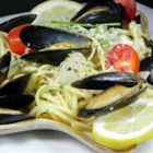 Mussels Mariniere - Fresh mussels, steamed in a fragrant broth of white wine, butter, onion, garlic, parsley, bay leaf and thyme, are arranged on linguini and served with more butter-enriched broth spooned over the top.