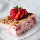 Frosty Strawberry Squares - Strawberry fluff is frozen on a sweet walnut crust before cutting into squares to serve. Enjoy this treat on a hot summer day.