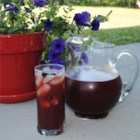 Raspberry Iced Tea - Lightly sweetened iced tea gets fruity, refreshing flavors, and a pretty pink color from fresh raspberries and lemonade mix for a perfect summer cooler.