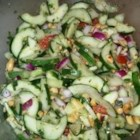 Asian Cucumber Thai Salad - A sweet and tangy cold cucumber salad has Thai-inspired flavors of cilantro, fresh mint, and peanuts.