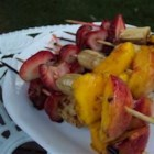 Grilled Fruit Kabobs - Yummy grilled dessert skewers of fresh peaches, plums, banana, and strawberries get a sweet honey topping before hitting the grill.