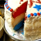 Surprise Inside Independence Cake - This three-layer cake has a star-spangled surprise inside when you cut and serve it -- red, white, and blue layers divided by thick white frosting. They'll ooh and aah when they see it.