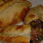Bolivian Saltenas - Like empanadas, these hand-held baked pastries are filled with spiced meat (beef or chicken) and vegetables. They make great appetizers, snacks, or lunches.