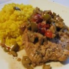 Olive Chicken II - Chicken breasts simmered with wine, chicken broth, olives, tomatoes and a smattering of herbs and spices. Serve with saffron rice, if desired.