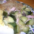 Stewed Squash - Yellow squash and zucchini are stirred in to sauteed onion and bacon and 'stewed' in water until tender.
