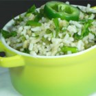 Green Rice III - Rice is simmered in chicken broth with jalapenos, green onions, and sherry, then tossed with cilantro and parsley for a spicy and unique side dish.