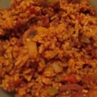 Jambalaya II - A whole chicken is stewed with smoked sausage, then combined with bell pepper, rice and tomatoes and flavored with chili powder, pepper sauce, cayenne and Worcestershire in this thick Cajun soup.