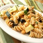 Pasta Chickpea Salad - The chickpeas make the pasta nutty and crunchy and the Parmesan cheese stirred in just before chilling adds a wonderful creaminess. There are also peas, oil-cured olives, green onions and fresh herbs. Chill overnight. Serves six.