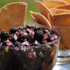 Raspberry Salsa - This salsa is sweet, tart and fresh, like a perfect summer day. Raspberries are blended with the vibrant flavors of jalapeno and cilantro to create a crowd pleasing topper for pork and other savory foods.