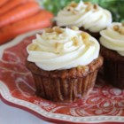 Carrot Cupcakes with White Chocolate Cream Cheese Icing - A moist and spicy carrot cake cupcake is topped with a cream cheese frosting flavored with a hint of white chocolate and orange.