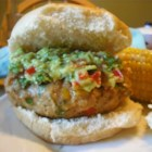 Green Chili Chicken Burgers - Guacamole and salsa give a Southwestern flair to flavorful grilled chicken burgers.
