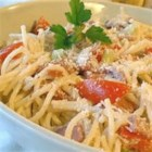 Summer Pasta Toss I - Zesty bits of salami are tossed with Parmesan cheese, fresh tomatoes, crunchy bell pepper and spaghetti to make a terrific summer salad. Drench with Italian-style salad dressing and chill before serving.