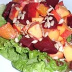 Beet, Orange and Apple Salad -  What a nice, colorful salad. Thick wedges of cooked beets, thinly sliced apples and orange sections are dressed with a delicious vinaigrette and spooned onto a bed of shredded beet greens.