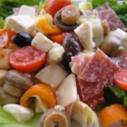 Antipasto Salad II - Two kinds of salami mix it up with two kinds of cheese, artichoke hearts, olives, tomatoes, and roasted red peppers in this colorful salad.