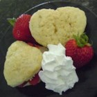 Heart-Shaped Strawberry Shortcakes - Cute heart-shaped strawberry shortcakes layered with berries and whipped cream make a special summertime dessert extra-special.
