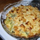 Creamy Broccoli Casserole - Broccoli is smothered with melted cream cheese and baked between layers of crushed crackers.