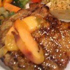 Pork Chops with a Riesling Peach Sauce - Under ripe peaches and Riesling wine are the secret to these delicious pork chops. The peaches simmer in the Riesling wine while the seared pork chops bake in the oven to create this quick and elegant meal.