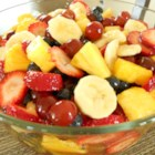 Perfect Summer Fruit Salad - Layers of fresh fruit are soaked a citrusy sauce in this colorful salad.