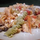 Chicken Pasta I - A wonderful change in light eating with pasta, chicken and vegetables. It is very low in fat and calories, but tastes delicious. Use your favorite pasta - we use mostaccioli pasta. Add some of your favorite veggies, if desired.