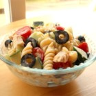 Yummy Pasta Salad - This recipe uses salad dressing to add flare to an ordinary pasta salad. It's great hot or cold and makes wonderful leftovers... if you manage to have any!