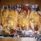 Sloppy Dogs - My Mama used to make this when I was a kid. It's a twist on the Chili Dog and we ate them with a fork.
