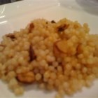 Couscous with Honeyed Almonds and Lemon - Israeli couscous is tossed with lemon zest and candied almonds.