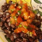 Black Beans with Pico de Gallo - These black beans topped with fresh tomato pico de gallo are a quick, easy to make supper!  My husband loves to eat beans this way and even offers to wash dishes after eating it!