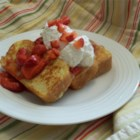 Gil's Brioche French Toast - Put the ooh-la-la into your French toast by using real brioche, the eggy, buttery bread from France. Unsweetened strawberry sauce helps cut the sweetness, and whipped cream amps up the richness. It's a special French toast for a special occasion.