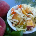 Thornehedge Peach Slaw - A refreshing summer slaw that blends the flavor of peaches, savoy cabbage, red bell peppers, and pecans. I first enjoyed this slaw at a garden party in Charleston several years ago and have served it each summer since to the delight of family and friends.