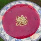 Roasted Beet and Potato Soup - This creamy beet and potato soup has a pretty color and rich flavor from roasting the potatoes and beets beforehand. The soup is thickened by blending the vegetables with an immersion blender.