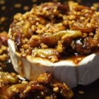 Figs and Toasted Almonds Brie - Brie cheese smothered with fresh figs cooked with brown sugar, vanilla, and almonds, then baked until almost melted. Serve warm with water crackers as a wonderful holiday appetizer or special treat during fig season. Canned figs in syrup may be substituted for fresh by reducing the brown sugar to 1/4 cup and replacing the water with syrup.