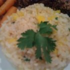 Mango-Lime Rice - Brown rice accented with lime and mixed with cilantro and mango makes a tasty side dish for fish or chicken.
