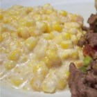 Slow Cooker Creamed Corn - Corn is combined with cream cheese, butter and milk, and simmered in the slow cooker.