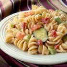 Italian Pasta Salad I - This fun salad has two dressings  - Italian and creamy Caesar. And with the exception of some diced bell pepper and onion, it 's all pasta.