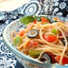 Sharese's Spaghetti Salad - Spaghetti, bacon, celery, onion, bell pepper, olives and tomatoes tossed with salad seasoning, Italian dressing and Parmesan and served cold.