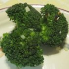 Brilliant Sauteed Broccoli - This recipe shows how you can shock your greens to stay brilliant, while making a presentation that says you really care about your food. The combinations of color with the bright green, red flakes, and white/brown topping is pleasing. The taste highlights sweet against spice, with a nice, crisp bite of seasoned broccoli.
